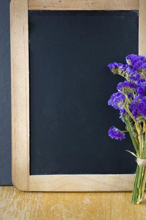 wooden frame blank chalkboard with purple flowers photo