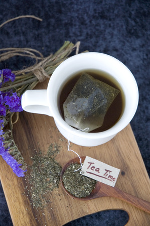 tea bag floating on hot tea cup