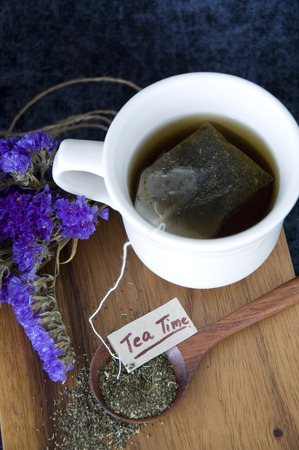 tea time concept hot tea cup with tea on wooden spoon photo