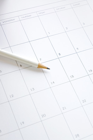 pencil point: white pencil point to date on white blank calendar