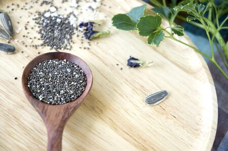 white chia: black and white chia seeds super food in wooden spoon Stock Photo