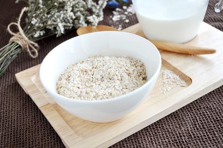 oatmeal bowl: oatmeal bowl on wooden tray Stock Photo