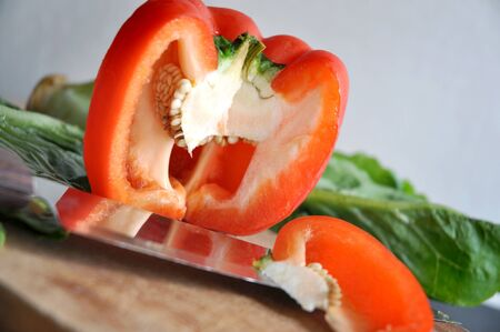 cutting: close up cutting red bell pepper on cutting board Stock Photo