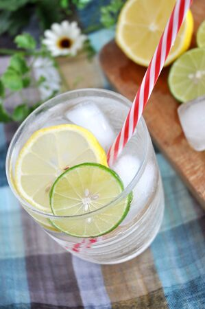 red straw: red straw in lemonade drink with lemon on background