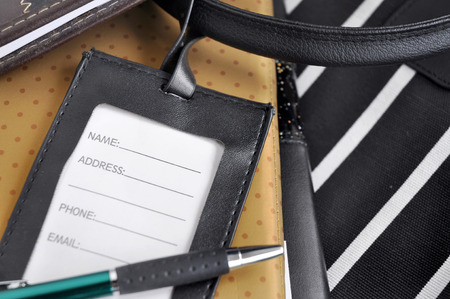luggage tag: blank luggage tag with pen put on organizer book