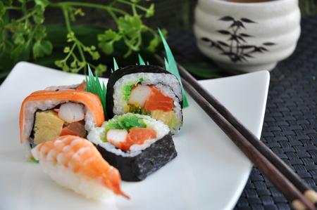 sushi plate: various sushi japanese food on white plate Stock Photo