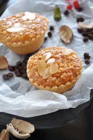 sweet tart: Two almonds sweet tart on crumpled paper put on tray