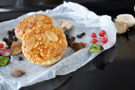 sweet tart: Sliced almonds and nuts sweet tart on tray Stock Photo