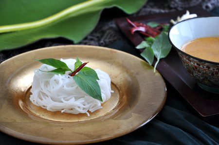 sauce bowl: Rice noodle on golden plate with spicy sauce bowl Stock Photo