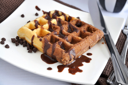 two tone: Two tone waffle with chocolate on white plate Stock Photo