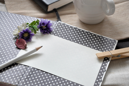 pencil point: Pencil point to blank paper on polka dots background decorated with flowers
