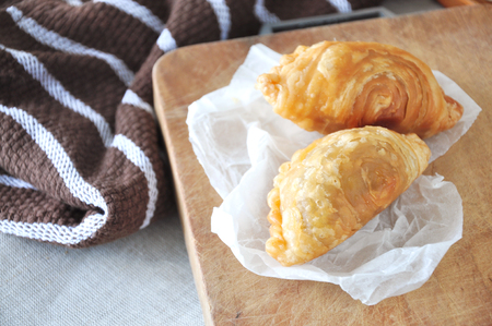 Curry puff put on wooden cutting board