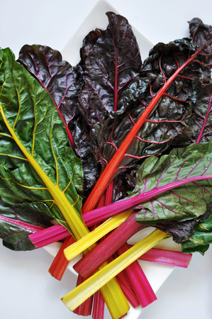 Above of fresh colorful Swiss Chard on white background