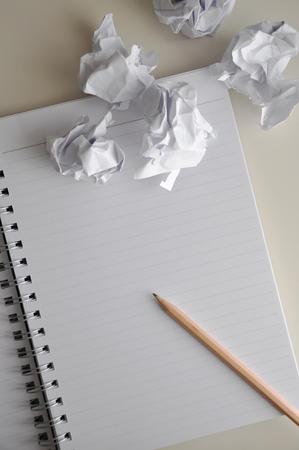 Pencil on blank page of notebook with crumpled paper throw on desk Stok Fotoğraf