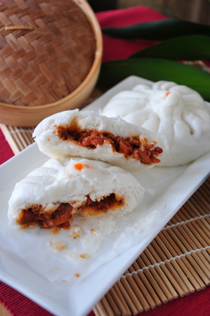 Pieces of Chinese red pork bun on white plate Stock Photo