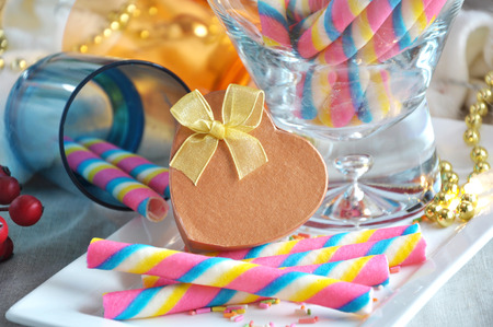 colourful lightings: Heart shape present box with colorful wafer stick on background