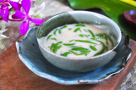 Close up Cendol bowl put on wooden board Stock Photo