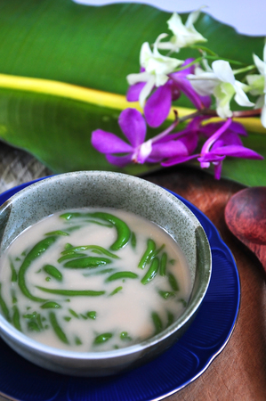 Close up Cendol Traditional Dessert with orchid and banana leaf decorated on background