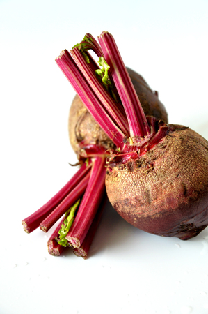 Close up fresh and raw beetroots on white background Banco de Imagens