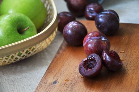 Close up juicy fresh plum put on wooden board Stock Photo