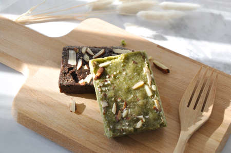 Healthy Dessert Matcha Green Tea and Dark Chocolate Brownie on Wooden Board with Fork