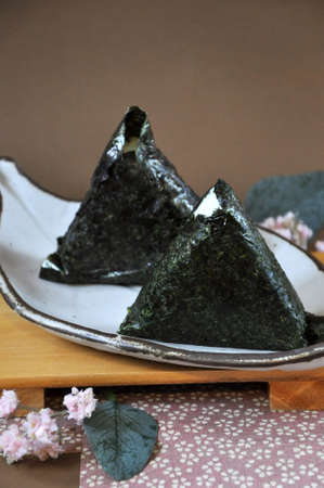 Clsoe up Onigiri Japanese food on plate with space for text on background