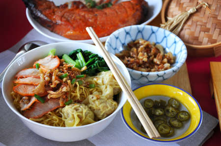Delicious Lunch set wanton noodles with Chinese style grilled pork Stock Photo