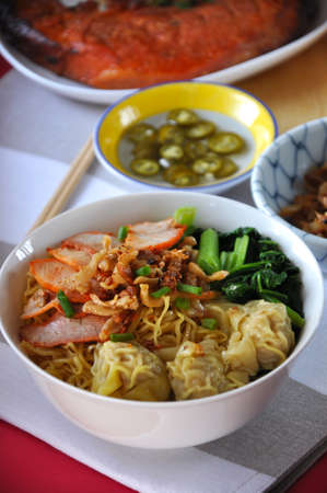 Close up big bowl of wanton noodles with grilled pork in Chinese style