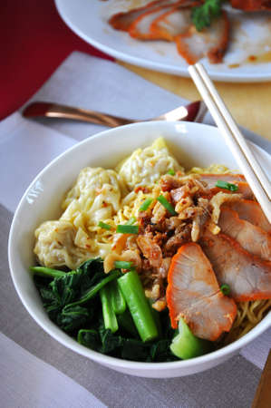Close up quick meal delicious wanton noodle with grilled pork