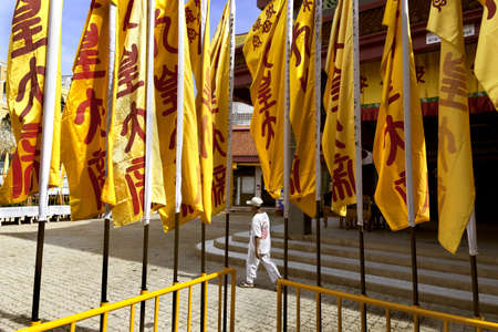 PHUKET, THAILAND - SEPTEMBER 22 2011: A row of yellow banners at the Jui Tui Chinese Shrine herald the advent of the annual Vegetarian Festival. Editorial