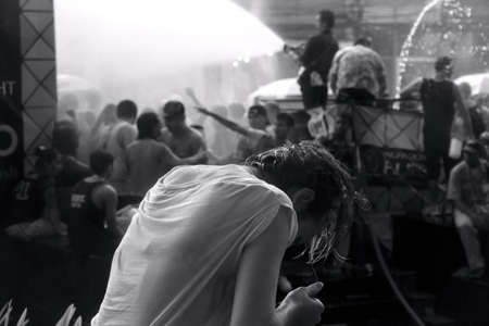 PHUKET, THAILAND APRIL 13 2013: A woman gets drenched with water at the 2013 Songkran Festival in Patong Beach.