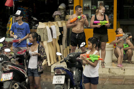 PHUKET, THAILAND APRIL 13 2013: A group of Thai locals and tourists seek targets to Throw Water at during the celebration of Songkran 2013 in Patong Beach.