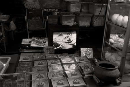 PHUKET, THAILAND - SEPTEMBER 26 2011: At the start of the annual Phuket Vegetarian Festival, an outdoor store in Phuket Town sells videos of a Ma Song (spirit medium) undergoing a ritual piercing.