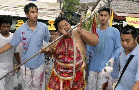 PHUKET, THAILAND - OCTOBER 3 2011: A Ma Song (vessel of the gods) returns to the Jui Tui Chinese Temple at the end of a street procession during the annual Phuket Vegetarian Festival in Phuket Town.