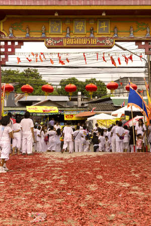 PHUKET, THAILAND OCTOBER 2 2011: The main gate of the Bang Niew Chinese Shrine in Phuket Town is littered with exploded firecrackers at the conclusion of a ceremony during the annual Phuket Vegetarian Festival.