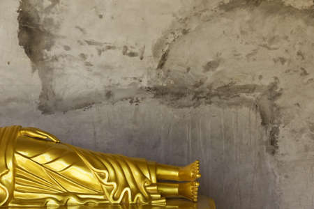 PHUKET, THAILAND FEBRUARY 15 2013: A reclining Buddha statue is one of many that encircle the base of the Big Buddha Monument, one of the most visited religious landmarks in Phuket. Stock Photo - 19639746
