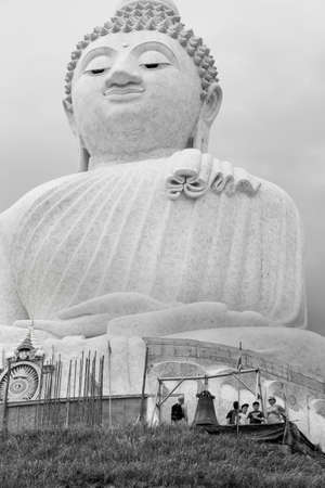 PHUKET, THAILAND FEBRUARY 15 2013: A group of tourists visit the top of Nakkerd Hill and The Big Buddha Monument, an iconic symbol of Thai Buddhism and one of the most visited religious landmarks in Phuket. Stock Photo - 19639741