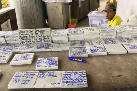 PHUKET THAILAND APRIL 4 2012: For a donation visitors can have their names written on bricks and slabs that are inserted into the Big Buddha Statue as materiel for ongoing maintenance.  Stock Photo - 19680297
