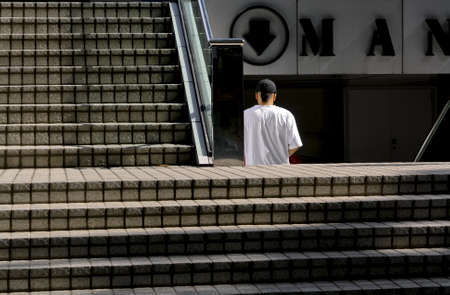 ORCHARD ROAD, SINGAPORE JUNE 6 2009: A man walks down some stairs into an shopping mall on Singapores Orchard Road.