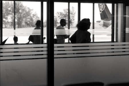 PHUKET INTERNATIONAL AIRPORT, PHUKET, THAILAND JULY 15 2012: Passengers board a flight.