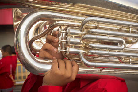 CHINESE NEW YEAR,  PHUKET, THAILAND, 7 FEBRUARY 2014: A member of a marching band performs during a parade celebrating the Chinese Lunar New Year in Phuket, Thailand.