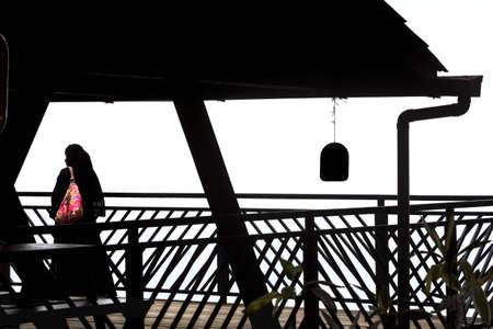 burqa: PENANG HILL VISTA POINT, PENANG, MALAYSIA,  5 MAY 2014: A Muslim woman in a burqa takes a moment to enjoy the view atop Penang Hill.