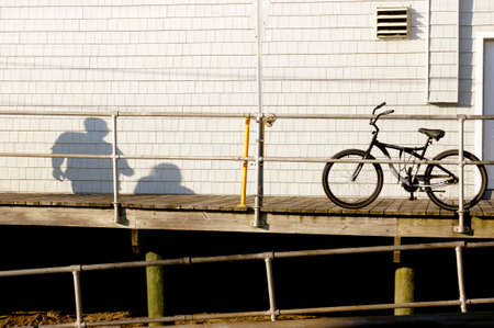 OCEAN CITY, NEW JERSEY, USA, 11 JULY 2010: A bicycle leans on a railing at the Ocean City boardwalk.