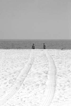 CAPE MAY POINT, NEW JERSEY, USA, 7 JULY 2010: Tread marks and swimmers at the beach, Cape May NJ. Editorial