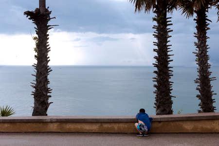 phrom: CAPE PROMTHEP, PHUKET, THAILAND, 30 NOVEMBER 2013: Chinese tourist enjoys view at Cape Promthep in Phuket.