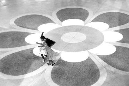 9 10 years: JUNG CEYLON MEGAMALL, PHUKET, THAILAND, 29 JUNE 2012: Two girls dance in an atrium of a shopping mall.