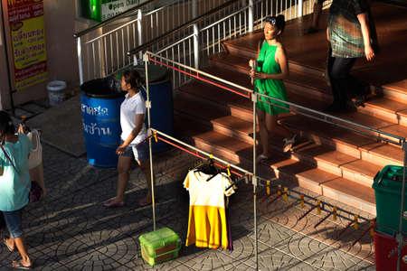BANZAAN MARKET, PATONG, PHUKET, THAILAND, 29 JUNE 2012: Shoppers exit the Banzaan Market in Patong Beach.