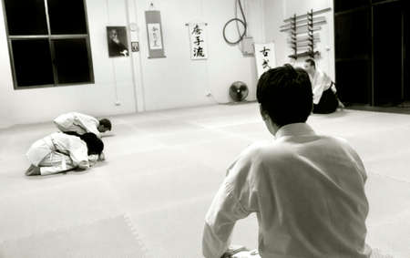 PHUKET TOWN, PHUKET, THAILAND, 3 MARCH 2014: Students of Aikido begin a promotion test in their dojang.