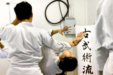 PHUKET TOWN, PHUKET, THAILAND, 3 MARCH 2014: Students of Aikido perform techniques on the mat during a promotion test. 報道画像