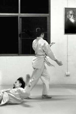 PHUKET TOWN, PHUKET, THAILAND, 3 MARCH 2014: Students of Aikido perform techniques durng a promotion test in Thailand.